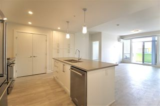 """Photo 1: 601 2565 WARE Street in Abbotsford: Central Abbotsford Condo for sale in """"MILL DISTRICT"""" : MLS®# R2440722"""