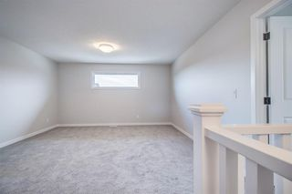 Photo 25: 12 Cranbrook Bay SE in Calgary: Cranston Detached for sale : MLS®# A1042185