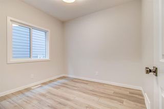Photo 18: 12 Cranbrook Bay SE in Calgary: Cranston Detached for sale : MLS®# A1042185