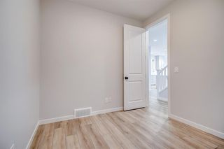 Photo 19: 12 Cranbrook Bay SE in Calgary: Cranston Detached for sale : MLS®# A1042185