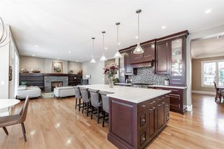 Photo 7: 8030 SPRING WILLOW Drive SW in Calgary: Springbank Hill Detached for sale : MLS®# A1058220