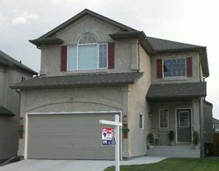 Photo 1: 10 RAVENSDEN Drive in Winnipeg: St Vital Single Family Detached for sale (South East Winnipeg)  : MLS®# 2613554