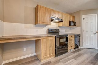 Photo 11: 52 COUGARSTONE Villa SW in Calgary: Cougar Ridge Detached for sale : MLS®# A1020063