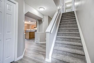 Photo 2: 52 COUGARSTONE Villa SW in Calgary: Cougar Ridge Detached for sale : MLS®# A1020063