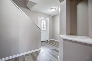 Photo 3: 52 COUGARSTONE Villa SW in Calgary: Cougar Ridge Detached for sale : MLS®# A1020063
