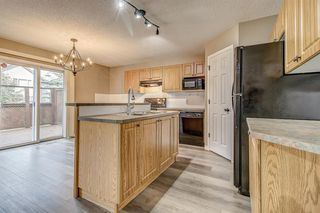 Photo 13: 52 COUGARSTONE Villa SW in Calgary: Cougar Ridge Detached for sale : MLS®# A1020063