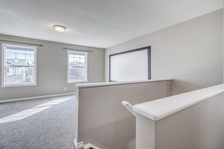 Photo 19: 52 COUGARSTONE Villa SW in Calgary: Cougar Ridge Detached for sale : MLS®# A1020063
