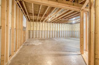 Photo 32: 52 COUGARSTONE Villa SW in Calgary: Cougar Ridge Detached for sale : MLS®# A1020063