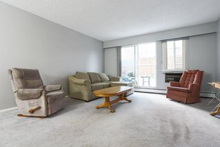 """Photo 1: 103 12096 222 Street in Maple Ridge: West Central Condo for sale in """"Canuck Plaza"""" : MLS®# R2521052"""