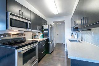 "Main Photo: 102 2299 E 30TH Avenue in Vancouver: Victoria VE Condo for sale in ""TWIN COURT"" (Vancouver East)  : MLS®# R2402315"