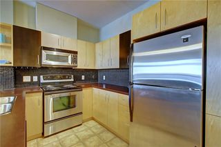 Photo 9: 234 69 SPRINGBOROUGH Court SW in Calgary: Springbank Hill Apartment for sale : MLS®# A1029583