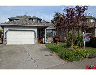 "Photo 1: 6828 181ST Street in Surrey: Cloverdale BC House for sale in ""Cloverwoods"" (Cloverdale)  : MLS®# F2711956"