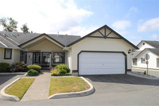 "Photo 1: 85 19649 53 Avenue in Langley: Langley City Townhouse for sale in ""Huntsfield Green"" : MLS®# R2399090"