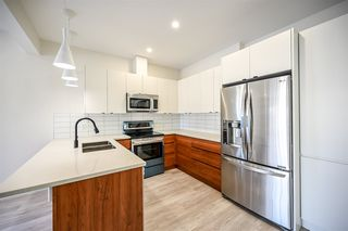 Photo 9: 10713 74 Avenue NW in Edmonton: Zone 15 Duplex Front and Back for sale : MLS®# E4189184