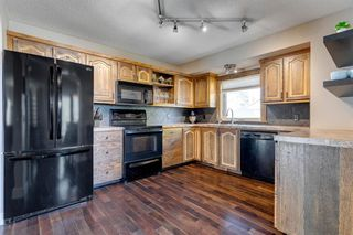 Photo 10: 75 Millbank Road SW in Calgary: Millrise Detached for sale : MLS®# A1037096