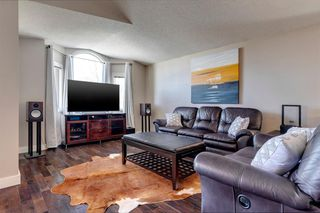 Photo 3: 75 Millbank Road SW in Calgary: Millrise Detached for sale : MLS®# A1037096