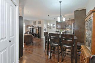 Photo 4: #104 6083 MAYNARD WY NW in Edmonton: Zone 14 Condo for sale : MLS®# E4165066