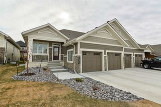 Photo 1: 4209 KENNEDY Court in Edmonton: Zone 56 House Half Duplex for sale : MLS®# E4204529