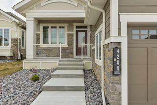 Photo 2: 4209 KENNEDY Court in Edmonton: Zone 56 House Half Duplex for sale : MLS®# E4204529