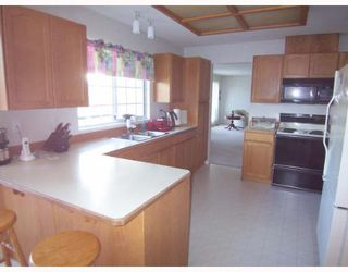 "Photo 4: 23638 108TH Loop in Maple Ridge: Albion House for sale in ""KANAKA CREEK"" : MLS®# V643760"