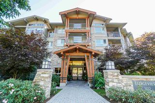 "Photo 1: 206 3110 DAYANEE SPRINGS Boulevard in Coquitlam: Westwood Plateau Condo for sale in ""LEDGEVIEW"" : MLS®# R2498071"