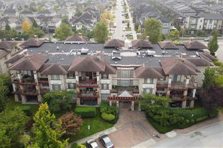 """Photo 1: 209 16477 64 Avenue in Surrey: Cloverdale BC Condo for sale in """"St Andrews"""" (Cloverdale)  : MLS®# R2527449"""