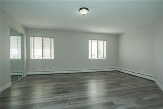 Photo 11: 420 33 ARBOUR GROVE Close NW in Calgary: Arbour Lake Apartment for sale : MLS®# A1012113