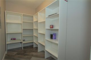 Photo 18: 420 33 ARBOUR GROVE Close NW in Calgary: Arbour Lake Apartment for sale : MLS®# A1012113