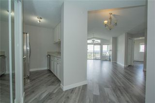 Photo 3: 420 33 ARBOUR GROVE Close NW in Calgary: Arbour Lake Apartment for sale : MLS®# A1012113