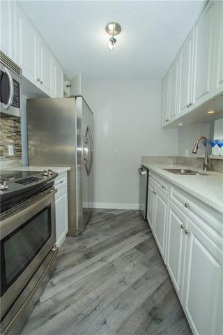 Photo 5: 420 33 ARBOUR GROVE Close NW in Calgary: Arbour Lake Apartment for sale : MLS®# A1012113