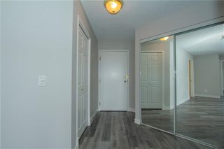 Photo 2: 420 33 ARBOUR GROVE Close NW in Calgary: Arbour Lake Apartment for sale : MLS®# A1012113