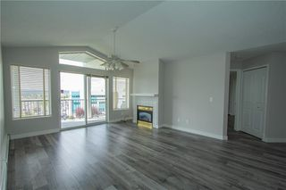 Photo 8: 420 33 ARBOUR GROVE Close NW in Calgary: Arbour Lake Apartment for sale : MLS®# A1012113