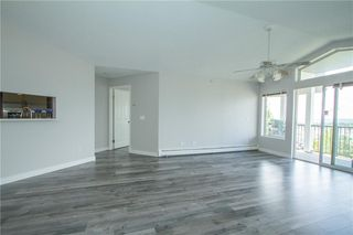 Photo 6: 420 33 ARBOUR GROVE Close NW in Calgary: Arbour Lake Apartment for sale : MLS®# A1012113