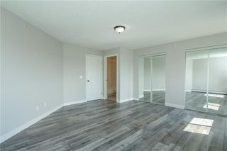 Photo 12: 420 33 ARBOUR GROVE Close NW in Calgary: Arbour Lake Apartment for sale : MLS®# A1012113