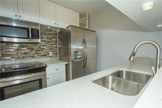 Photo 4: 420 33 ARBOUR GROVE Close NW in Calgary: Arbour Lake Apartment for sale : MLS®# A1012113