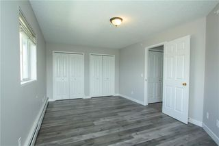 Photo 14: 420 33 ARBOUR GROVE Close NW in Calgary: Arbour Lake Apartment for sale : MLS®# A1012113