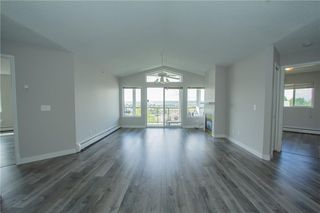 Photo 7: 420 33 ARBOUR GROVE Close NW in Calgary: Arbour Lake Apartment for sale : MLS®# A1012113