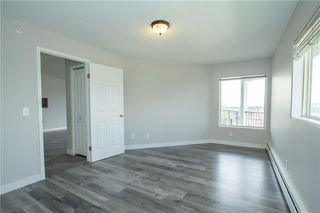 Photo 15: 420 33 ARBOUR GROVE Close NW in Calgary: Arbour Lake Apartment for sale : MLS®# A1012113