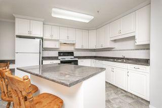 Photo 6: 111 8215 84 Avenue NW in Edmonton: Zone 18 Condo for sale : MLS®# E4174962