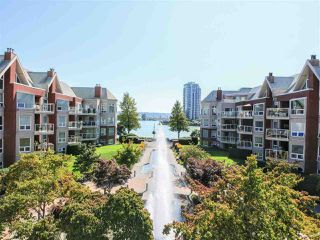 "Photo 1: 208 1230 QUAYSIDE Drive in New Westminster: Quay Condo for sale in ""Tiffany Shores"" : MLS®# R2432289"
