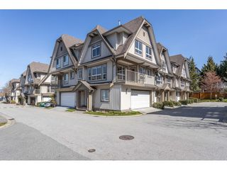 "Photo 1: 13 12738 66 Avenue in Surrey: West Newton Townhouse for sale in ""STARWOOD"" : MLS®# R2450480"
