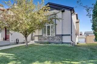 Photo 3: 64 EVERRIDGE Way SW in Calgary: Evergreen Detached for sale : MLS®# A1036699