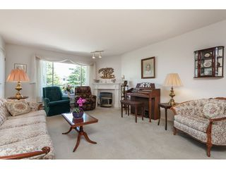 """Photo 9: 201 5375 205 Street in Langley: Langley City Condo for sale in """"Glenmont Park"""" : MLS®# R2482379"""