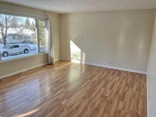 Photo 4: 232 Queensland Road SE in Calgary: Queensland Detached for sale : MLS®# A1058623