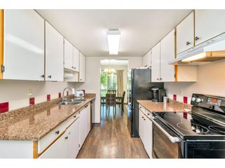 """Photo 8: 103 7349 140 Street in Surrey: East Newton Townhouse for sale in """"Newton Park"""" : MLS®# R2464654"""