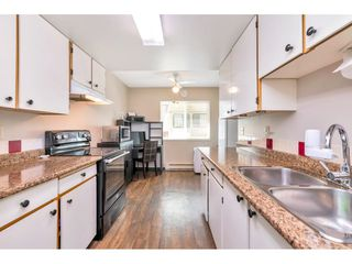 """Photo 6: 103 7349 140 Street in Surrey: East Newton Townhouse for sale in """"Newton Park"""" : MLS®# R2464654"""