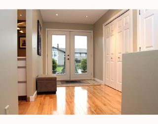 """Photo 2: 1645 53A Street in Tsawwassen: Cliff Drive House for sale in """"CLIFF DRIVE"""" : MLS®# V682446"""