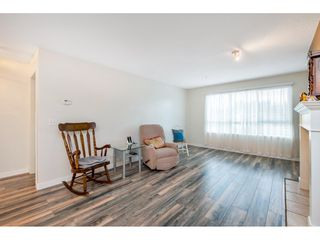 "Photo 7: 331 13880 70 Avenue in Surrey: East Newton Condo for sale in ""Chelsea Gardens"" : MLS®# R2528464"