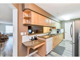 "Photo 12: 331 13880 70 Avenue in Surrey: East Newton Condo for sale in ""Chelsea Gardens"" : MLS®# R2528464"