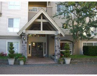 "Photo 2: 407 1242 TOWN CENTRE Court in Coquitlam: Canyon Springs Condo for sale in ""KENNEDY"" : MLS®# V668962"